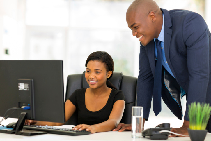 african businesspeople working on computer